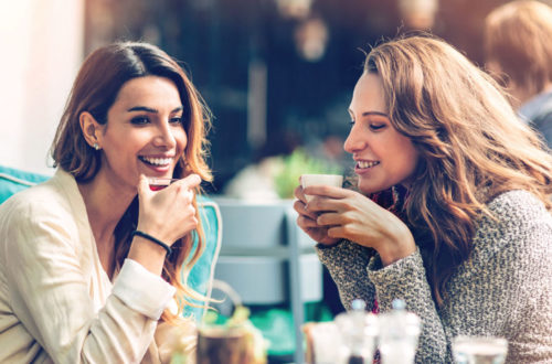 Two Women enjoy beverages on a patio